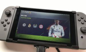 Nintendo Switch Gray + FIFA 18 (Nintendo Switch) Thumbnail 2